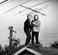 Lucy & Ethel putting up T V Antenna