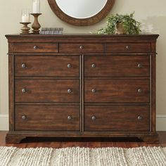 A distressed and burnished brown finish gives an authentic, relaxed feel to the Schaffer dresser. Designed to give your bedroom a welcoming look, the casual style is embellished with crown molding and bracketed feet for just a touch of traditional beauty. Six generous storage drawers offer space for everything from jeans to sweaters, while three shallow drawers easily keeps accessories and jewelry organized.