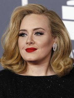 AdeleWhat: The retro swirlWhy we like: Charming and sophisticated, Adele's soft blonde hairdo at the Grammys looked ravishing against her bright red lipstick. We love how it parts enough to show her perfectly picked diamond earrings.Where to wear: Take this retro look to a cocktail party and floor \'em all!