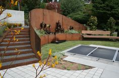 Use metal to create a retaining wall and save a ton of space compared to the materials that are regularly used to create retaining walls. - Contemporary landscape by Banyon Tree Design Studio
