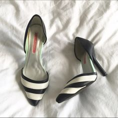 Black and white striped d'orsay pumps Gently worn d'orsay pumps with black and white striped toe. The perfect contrast to a basic outfit! Slight nick on tip of left toe. Some wear on the back of heels, but overall great condition! Shoes Heels