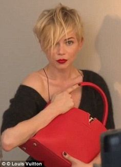 Michelle Williams models the different colours of the bag