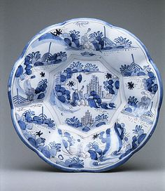 Dish with figures in a landscape, Delftware in imitation of mid 17th c. Japanese pottery, Late 17th C.