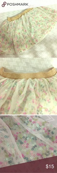 Cat and Jack Sequin Skirt Your little one will love this skirt! Ivory skirt with pink, fuchsia, teal, and green sequins. Gold band adds more flair. Perfect condition. Worn only once for pictures. Cat and Jack Bottoms Skirts