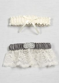"Trimmed with delicate lace, this garter set has the perfect vintage charm while incorporating your David's Bridal exclusive wedding colors. Embellished with a faux pearl bead and rhinestone applique, this garter set is the perfect compliment to wear on your big day.  Features and Facts:   Keepsake garter: 12.5"" around unstretched and 3"" width  Toss garter: 12.5"" around unstretched and 1.5"" wide  Made of satin and lace with faux pearls and rhinestones"