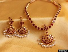 South indian style maroon stone necklace set along with pair of gorgeous earrings.
