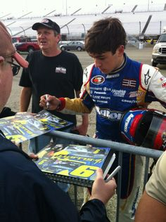 Hendrick Motorsports driver Chase Elliott signs autographs for fans at Richmond International Raceway on April 26.