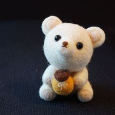 Handmade white needle felted bear cub with a honey jar on Etsy, $380.00 HKD
