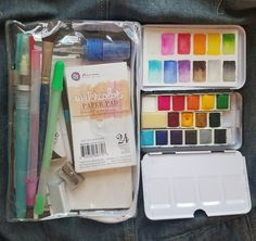 Downsizing my watercolor sketching kit. Walgreens $5.99 cosmetic travel bag with spray bottle. Prima watercolor tin fits inside. Nice vibrant colors and includes small watercolor block!