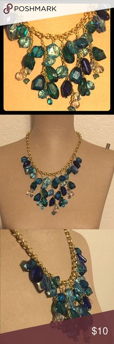Stunning blue and gold statement necklace From the Sally C collection at Charming Charlie. This necklace really is stunning on, dresses up even the most simple outfit. Blue sparkly beads on a chunky gold chain. Charming Charlie Jewelry Necklaces