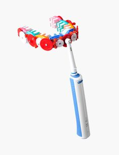 It's an electric toothbrush that brushes both the top and bottom teeth at the same time!