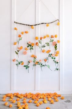 Create a simple DIY flower wall hanging for your wedding photo backdrop with affordable fake flowers from Afloral.com.