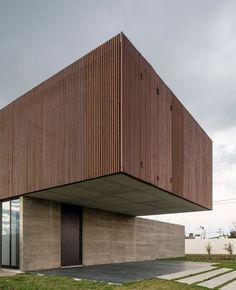 MAPA Architects have designed a single family residence, located near Porto Alegre, Portugal.