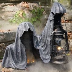 Provoke some disturbed double-takes when your guests spot our ghastly Ground Reaper Statue.Grandin Road Ground Reaper Statue Appearing to emerge from a stone walkway or wall, this hooded specter has a weathered, time-worn appearance, and can be illum Casa Halloween, Halloween Tags, Halloween Displays, Outdoor Halloween, Holidays Halloween, Halloween Crafts, Happy Halloween, Vintage Halloween, Halloween Costumes