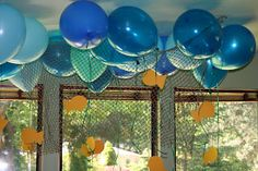 Fish hanging from helium balloon streamers. Cute! Would work for an Under the Sea, Finding Nemo, Little Mermaid or Octonauts party.