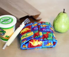 An easy to make sandwich wrap that you can use again and again! Colorful fabrics and iron-on vinyl make these wrappers machine-washable, leak-resistant, and too cute to resist. Fold your sandwiches inside and secure with Velcro. Then open them up and use as a placemat!