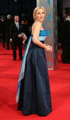 LOVING Gillian Anderson in @WilliamVintage 1949 Balmain haute couture in blue silk & chiffon with Adler sapphires! #EEBAFTAs #BAFTA2014