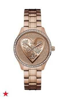 It's time to upgrade your wristwear with a GUESS stainless steel, bracelet watch. Style your everyday look with a glittery, rose goldtone dial and heart centerpiece design. Shop now!