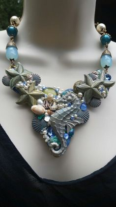 August challenge piece. Sea Garden using B'Sue starfish and seahorse colored with Perfect Pearls, moonglow, Vintage glass and pearl cabs, no hole pearls and pearl microbeads, shell  charms, seashells and a Verdigris mermaid.
