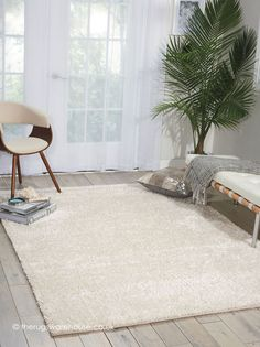 Fantasia Snow Rug, a handmade wool (75%) & polyester (25%) multi-textured shaggy rug in shades of cream http://www.therugswarehouse.co.uk/fantasia-snow-rug.html #rugs #shaggyrugs