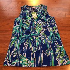 Lilly Pulitzer Essie Top Lilly Pulitzer Essie top in blue crush bamboom print size XS. Bought during APS. Still has tags, never worn. Selling for price I paid plus shipping Lilly Pulitzer Tops