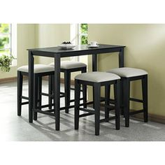 @Overstock.com - Black Grain Counter Height Table - Enjoy delicious meals at home at this wooden black counter-height table which seats four. Its built-in footrest supports your feet while you're seated. The table's luxurious black grain finish contrasts nicely with lighter colored decor.  http://www.overstock.com/Home-Garden/Black-Grain-Counter-Height-Table/6291879/product.html?CID=214117 $186.99