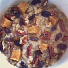 Sticky Buns Oats  1/2 cup rolled oats  1 tbsp. chia seeds  1 cup water  Microwave 1 min. stir and add 1/4 cup liquid egg whites, microwave another 30 sec.  Top with half a broken up cinnamon roll quest bar, raisins, pecans & maple syrup.