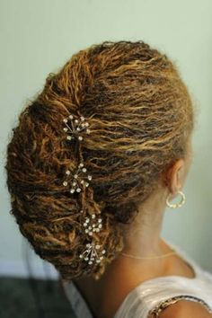 Hairstyles Known As Naturals Crossword : Paula Taft wears her hair natural in a style known as