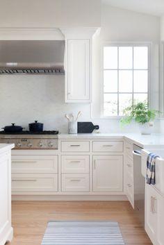 white kitchen white marble counters dash and albert runner face frame kitchen megan bachmann interiors