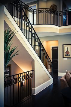 A modern railing can increase the visual appeal of your stairs and potentially the value of your home. Learn about our modern railing design process. Modern Staircase Railing, Wrought Iron Stair Railing, Metal Balusters, Balustrades, Modern Stairs, Staircase Design, Iron Railings, Banisters, Balcony Railing Design
