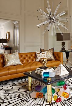 The Jonathan Adler Jacques Sputnik Chandelier and a scattering of Lucite Pills add an unexpected twist to any living room