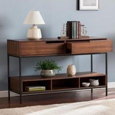 Everett Console - Southern Enterprises to be different; mix up your look with this multifunctional console table. Sleek, midcentury modern inspired silhouette constructs ample storage through drawers, compartments, and shelving. Modern Console Tables, Sofa End Tables, Entryway Tables, Living Room Furniture, Modern Furniture, Luxury Furniture, Modern Sofa, Table Furniture, Muebles Living