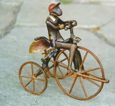 victorian childrens toys | Period Antique Victorian cast iron Monkey on a Bike toy