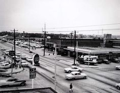 This vintage photograph shows the early years of the shopping center, which continues to thrive. Highland Village