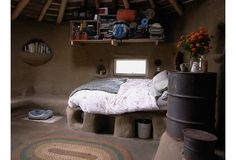 I love all the storage in this bedroom of a cob house!