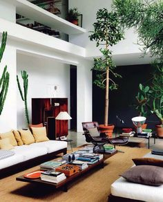 Great architectural design. Love the height of the living room. Enough space for indoor trees! And I love an Eames chair. Nice low coffee table too.