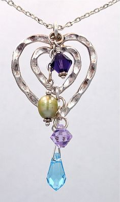 I'm thinking one heart for each baby lined with their birthstones.  And matching earrings.