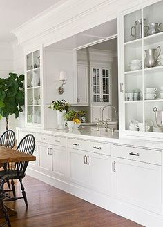 love the serving area between kitchen and dining area. with lots of storage