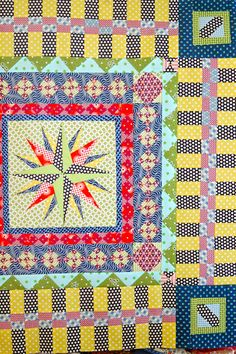 Although the maker is not sure, I know that I like this combination of bright prints!