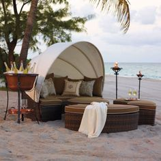 Coolest outdoor furniture EVAH and what a romantic beach setting! Wish I was there NOW. www.frontgate.com