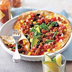 Chorizo-Topped Mexican Pizza - Bring a zesty flair to chunky salsa with corn and beans and Mexican shredded cheese on this mini chorizo pizza that can be ready to serve in less than 30 minutes. Chorizo Recipes, Pizza Recipes, Cooking Recipes, Cooking Ideas, Mexican Pizza, Mexican Dishes, Mexican Chorizo, Italian Recipes, Mexican Food Recipes