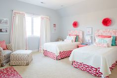 Shared Girls Room - love the pops of pink and darling upholstered headboards!
