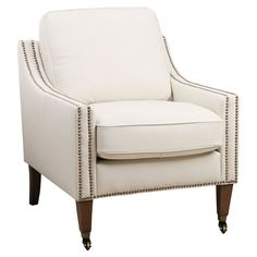 A classic addition to your reading nook or den, this chic chair features faux leather upholstery and timeless nailhead trim.   Prod...