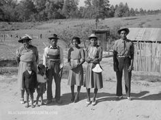 This family, also wearing their Sunday Best, is returning home from a funeral service at a nearby church in Greene County, Georgia (1941). From the Black History Album.