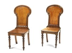 A pair of large Victorian oak hall chairs (2)