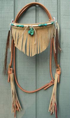 Turquoise fringed headstall. Very nice.