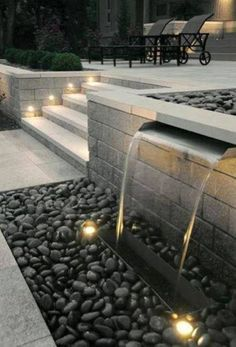 Progress: Week 4 like the water blade, and lighting on steps. Water feature and exterior lighting designed by Paver Planet, Inc. Morelike the water blade, and lighting on steps. Water feature and exterior lighting designed by Paver Planet, Inc. Modern Backyard, Modern Landscaping, Backyard Landscaping, Backyard Waterfalls, Landscaping Ideas, Backyard Ideas, Landscaping Software, Black Rock Landscaping, Modern Pond