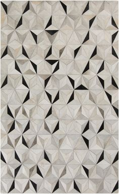 Hard to believe this stunning geometric rug is made of 100% leather. Well it's true. Part of the Trail Collection by Surya. (TRL-1128)