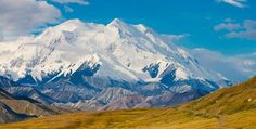 Alaska's Denali National Park: For centuries, the Athabascans of central Alaska looked up at this 20,320-foot mountain and called it Denali, 'the Great One'. Then, in 1896, businessman-turned-prospector William Dickey rechristened it in honour of President William McKinley, who hailed from Ohio and had never set foot in Alaska. That's never sat well with a lot of Alaskans. But whatever you call the mountain, its grandeur transcends any language. Photo by Michael DeYoung.