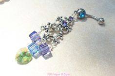 #YOUniqueDZignsArtfire on Artfire                   #ring                     #Chandelier #belly #ring #with #purple #crystals #green #crystal #heart       Chandelier belly ring with purple crystals and green crystal heart 14g                                  http://www.seapai.com/product.aspx?PID=680586